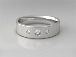 Anillo en Oro blanco 18K con 3 Diamantes (total 0.160q.)